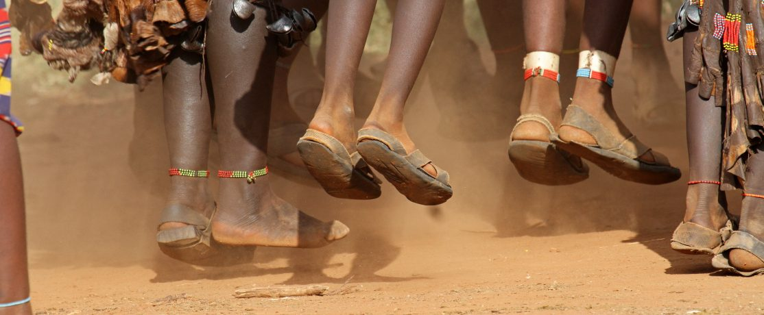 The feet of Hamar women, a primitive tribe, dancing during a bulljump ceremony in the Omo valley in the South of Ethiopia